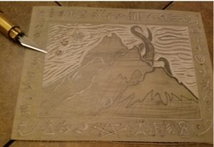 About half way carved before detailing the mountains.